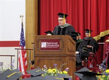 Photo of Dr. Eliot Edwards addressing graduates