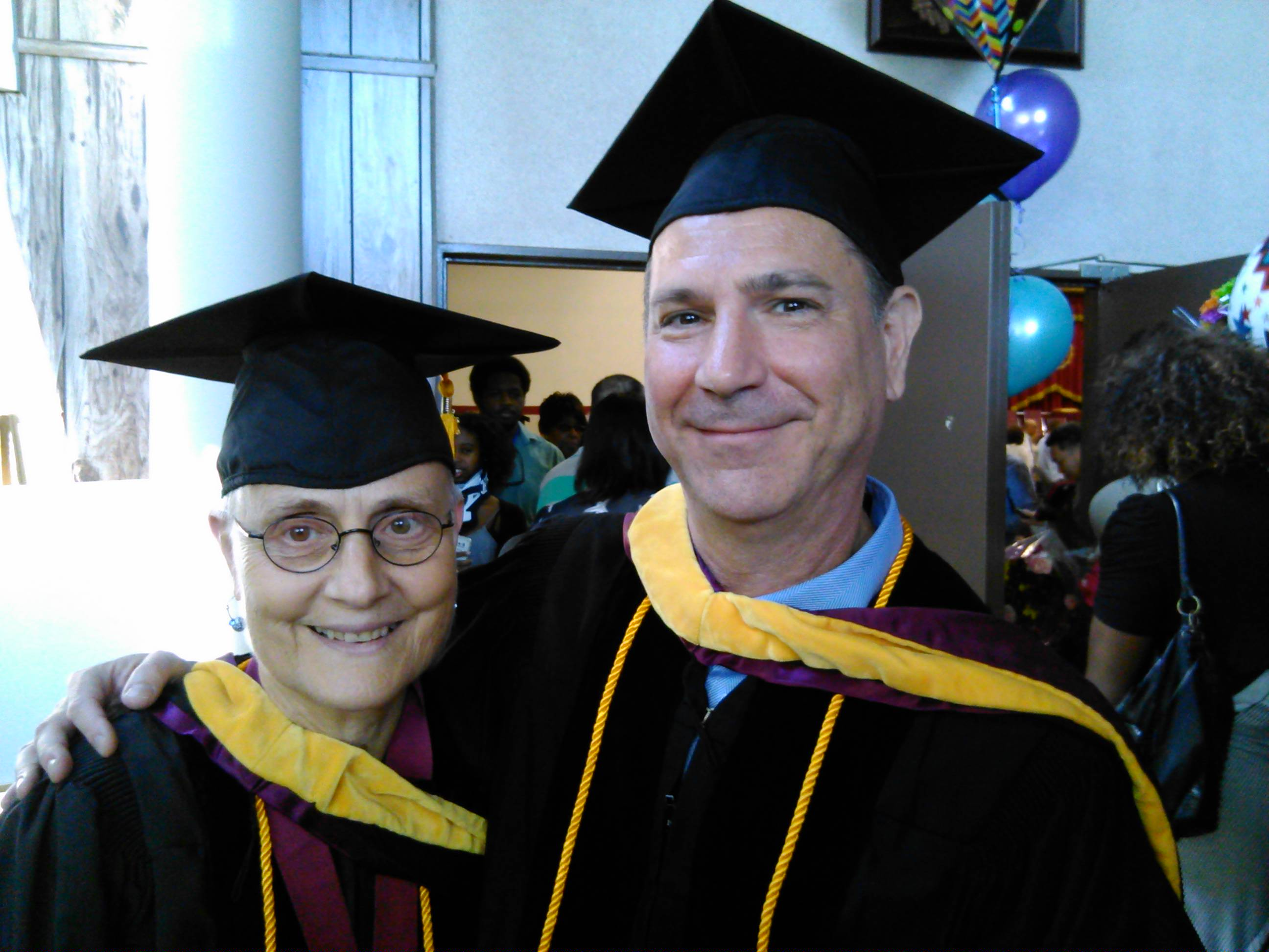 Photo of Linda Oster and Robert Fischer at graduation