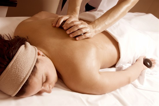 Photo of woman receiving a massage